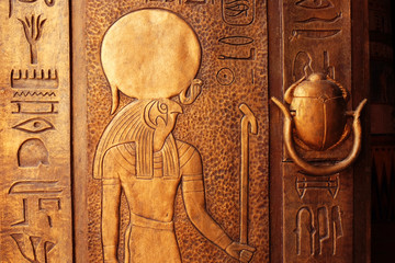 Ancient egypt scene. Hieroglyphic carvings on the exterior walls of an ancient egyptian temple