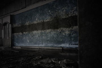 painted flag of botswana on the dirty old wall in an abandoned ruined house.