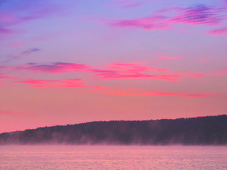 Wall Mural - Foggy morning sunrise over the lake. Beautiful view of bright colorful sky and misty effect over tranquil water surface in summer. Elovoe Lake (Spruce Lake), South Ural, Russia, South Ural, Russia.