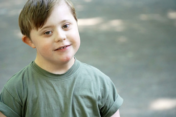 Portrait of a little boy with down syndrome