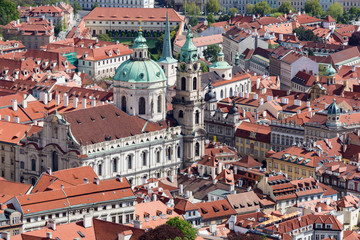 Rofs of old Prague with church of St. Nicolas on a bright Autumn day