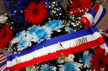 A wreath of flowers in the colour of the French flag is seen after a ceremony at Normandy American Cemetery and Memorial, in Colleville-sur-Mer