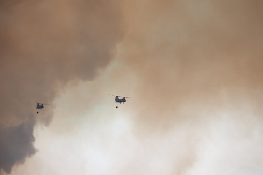 helicopter fighting wildfires in southern California