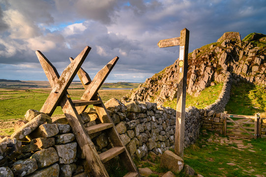 Pennine Way Style and Sign Post at Hadrian's Wall, a UNESCO World Heritage Site in the beautiful Northumberland National Park. popular with walkers along the Hadrian's Wall Path and Pennine Way
