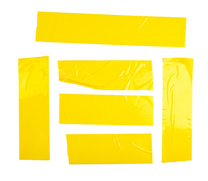 Set of yellow tapes on white background