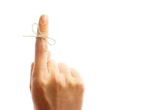 White String Tied Around a Finger