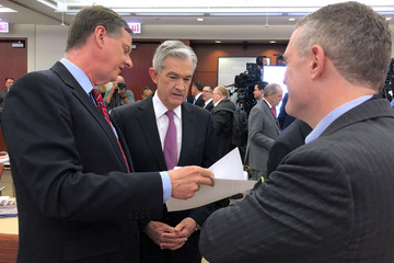 Federal Reserve Chairman Jerome Powell speaks with Chicago Fed President Charles Evans and St Louis Fed President James Bullard at a conference on monetary policy at the Federal Reserve Bank of Chicago
