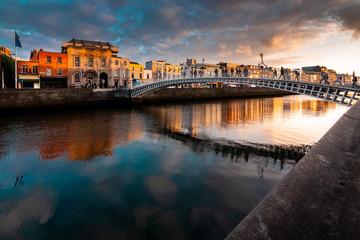 Ha'penny Bridge is over river  Liffey  in sunset, Dublin, Ireland Wall mural