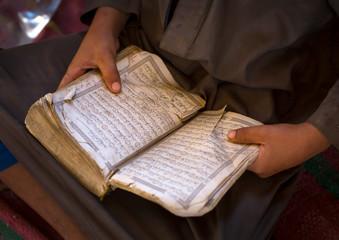 Sudan, Kassala State, Kassala, rashaida tribe kid reading quran in a coranic school