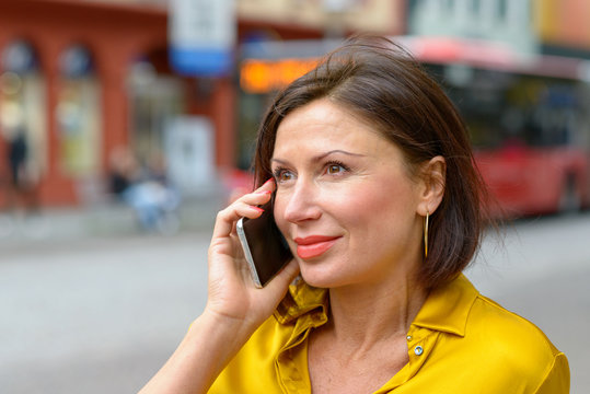 Attractive woman smiling as she listens to a call