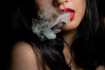a woman blowing smoke