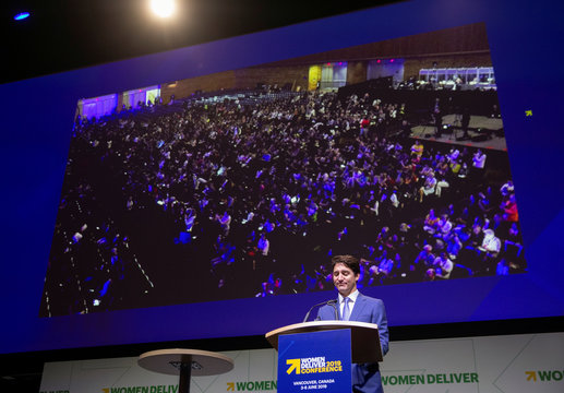 The audience stands and claps as Canada's Prime Minister Trudeau announces a $1.4 billion annual commitment to support women's global health at the Women Deliver 2019 Conference at the Vancouver Convention Centre in Vancouver