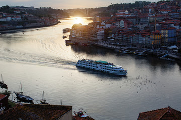 Top view of Douro river and Ribeira at dusk in Porto, Portugal.