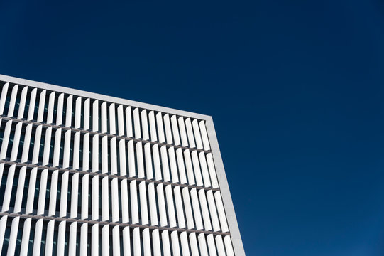 Modern office building with vertical shutters to screen the sun