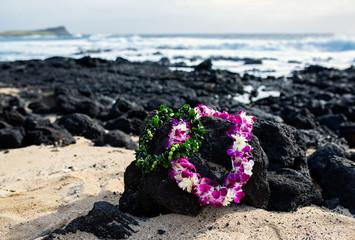 Wedding Leis on Rocks at Oahu Hawaii Beach
