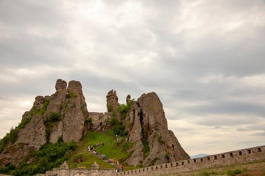 Tourists climbing fortress of Belogradchik Rocks Bulgaria