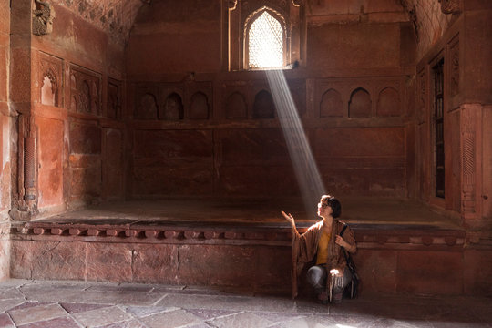 30 years old caucasian girl hit by a ray of sun inside Agra Fort India