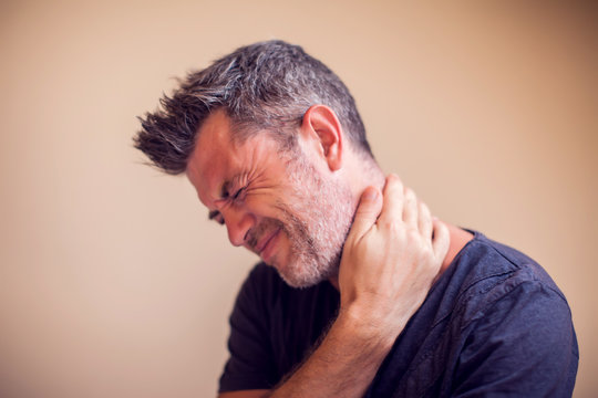 Man feels neck pain isolated. People, healthcare and medicine concept