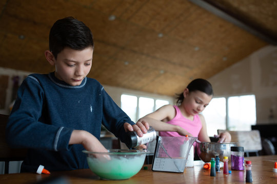 Tweens making slime with glue and glitter