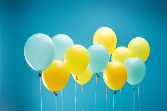 colorful yellow and blue balloons on blue background