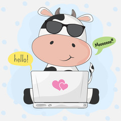Cute cartoon cow playing in computer game through the Internet