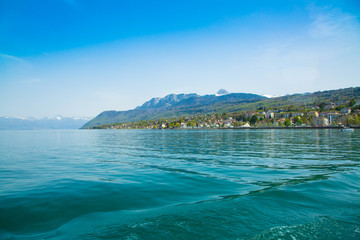 View from ferry boat of Lake Geneva and Evian-les-Bains city in France