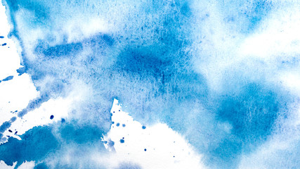 Abstract watercolor painting. Textured background. Drips of blue paint on canvas.