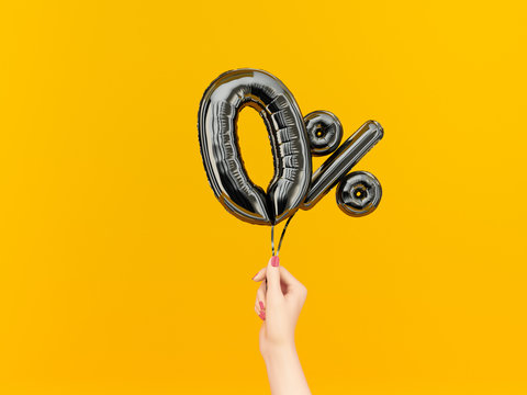 Female hand holding Zero percent symbol. 0 % offer black flying foil balloons on yellow. Loan rate fee concept. 3d rendering.
