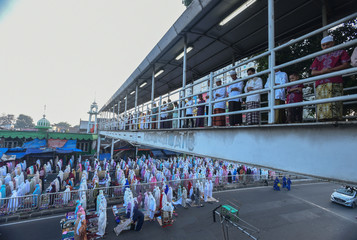Indonesian Muslims attend morning prayers to celebrate Eid al-Fitr, marking the end of the holy fasting month of Ramadan, at Gembrong market in Jakarta