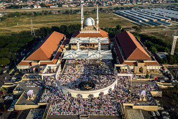 An aerial picture of Indonesian Muslims attending morning prayers to celebrate Eid al-Fitr, marking the end of the holy fasting month of Ramadan, at Great Mosque of Central Java in Semarang