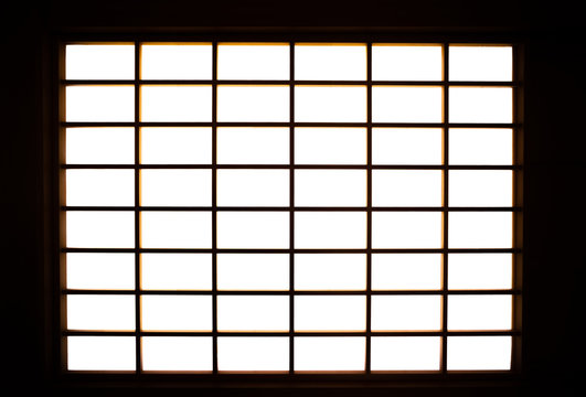 Lights shining into the room from the shoji screen window. Japanese architecture for door or window for room divider.