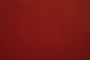 Maroon red felt texture abstract art background. Colored construction paper surface. Empty space.