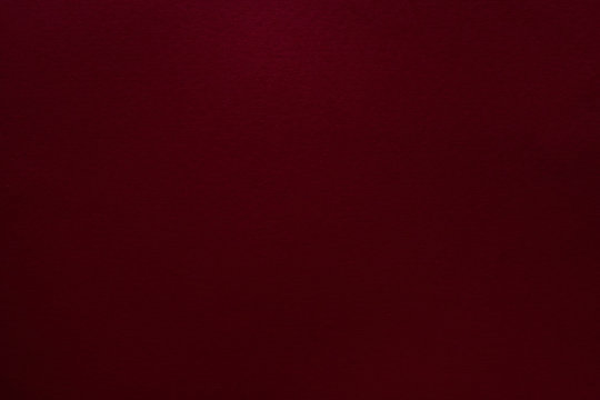 Burgundy red felt texture abstract art background. Solid color construction paper surface. Copy space.