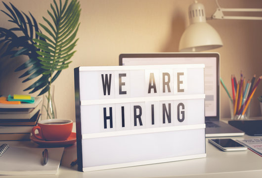 We are hiring text on light box on desk office