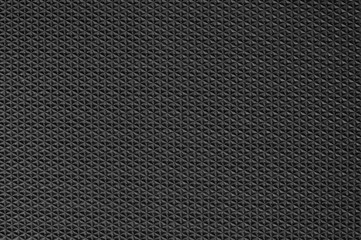 Black rubber texture background with seamless pattern. Wall mural