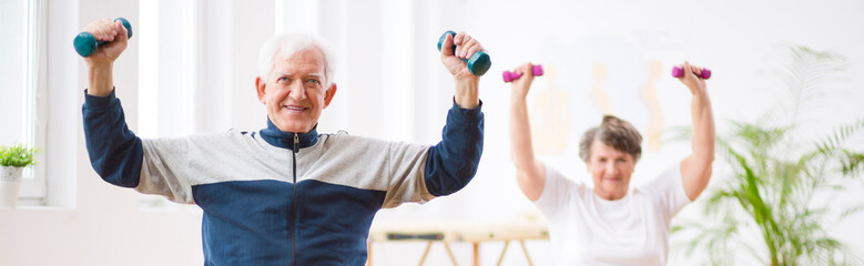 Panorama capture of two senior man and woman working out with weights