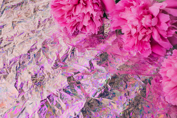 Photo sur Aluminium Fleurs Vintage Beautiful pink peony flowers on holographic background. Trendy texture. Neon colored texture for your design.