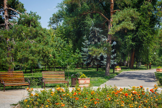 View of the benches in 28 Panfilov city park in Almaty, Kazakhstan.