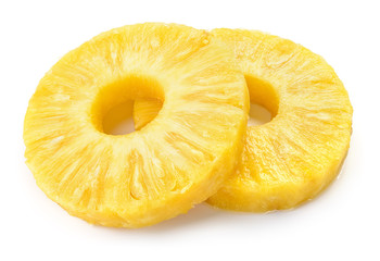 Pineapple rings. Canned pineapple slices isolated on white. Wall mural