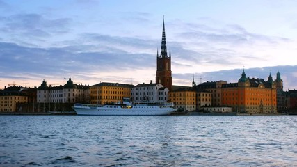 Wall Mural - Stockholm, Sweden. View of Gamla Stan in Stockholm, Sweden with landmarks like Riddarholm Church during the morning