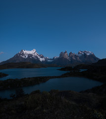 Torres del Paine National Park during the twilight before sunrise with some bright stars in the sky. Chile