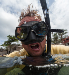 Portrait of the crazy diver with black mask and snorkel