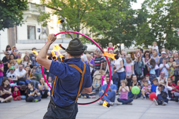 Street performer with a fire wheel