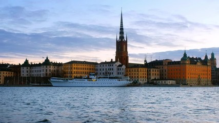 Fototapete - Stockholm, Sweden. View of Gamla Stan in Stockholm, Sweden with landmarks like Riddarholm Church during the morning, zoom out