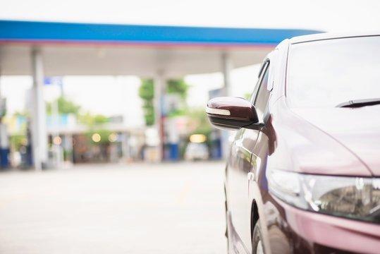 Car parking in gas fuel station - car energy transportation concept