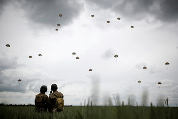 Paratroopers jump during a commemorative parachute jump over Sannerville as France prepares to commemorate the 75th anniversary of the D-Day