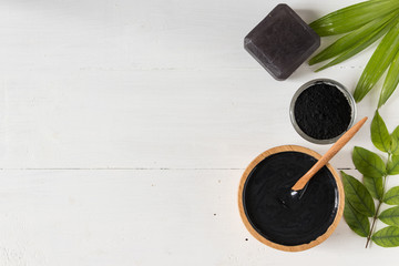 Homemade skin remedies and facial care, activated black charcoal and yogurt mask, cosmetic product
