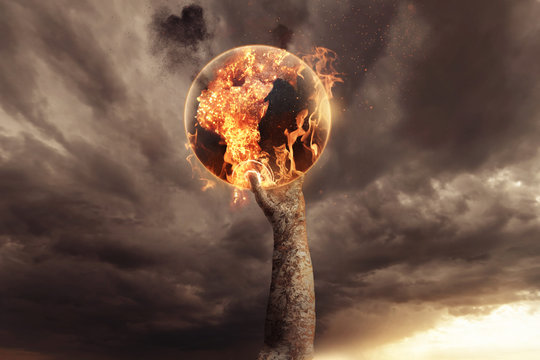stone hand holding burning earth and rise up in the apocalyptic sky