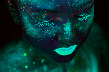 UV painting of a universe on a female body portrait