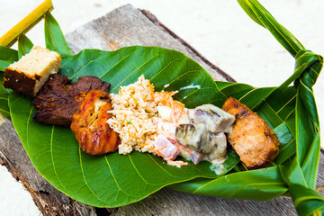 Fried meat with rice on a banana leaf, Bora Bora, French Polynesia. Close-up.
